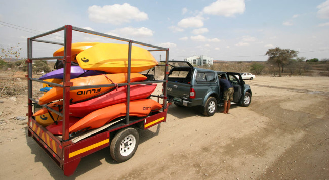 Trailer loaded with a variety of kayaks.