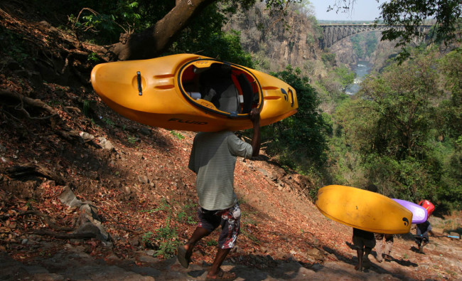 Porters showing off why they're the envy of many kayakers.