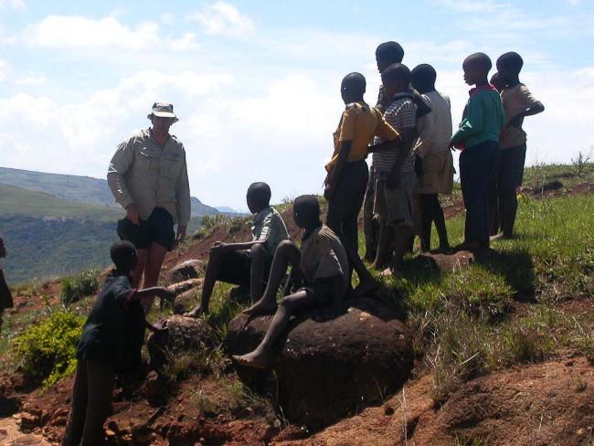 Hugh negotiating with child-sze porters.