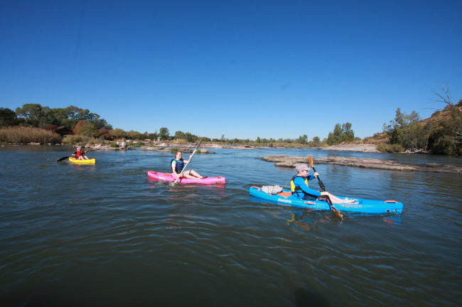Kyla, Ruben and friend Ethan paddling with Kwandos on the Vaal.