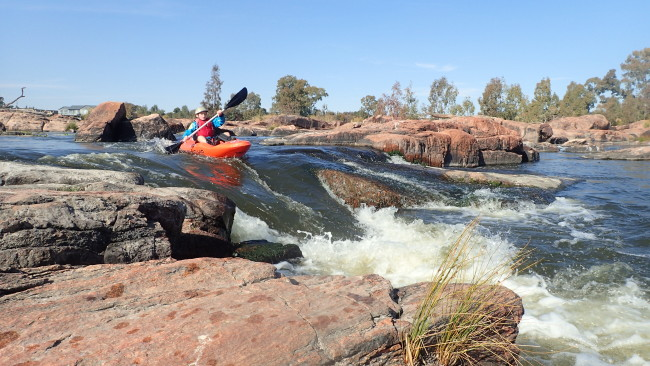 "Ruben running a rapid on our local ""Top Section"" outside Parys on the Vaal - age 10."