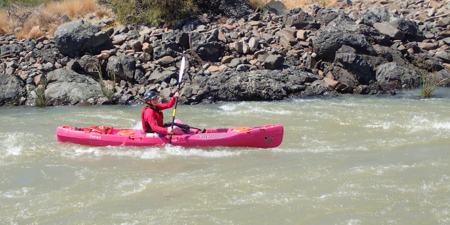 Kyla paddling her Tarka on the Thunder Alley section of the Orange River - age 13
